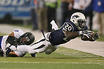 Nevada's James Butler (20) stretches for extra yards against Boise State's Kamalei Correa (8) during the second half of an NCAA college football game in Reno, Nev, on Saturday, Oct. 4, 2014. (AP Photo/Cathleen Allison)