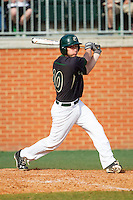 Nick Daddio (20) of the Charlotte 49ers follows through on his swing against the Canisius Golden Griffins at Hayes Stadium on February 23, 2014 in Charlotte, North Carolina.  The Golden Griffins defeated the 49ers 10-1.  (Brian Westerholt/Four Seam Images)