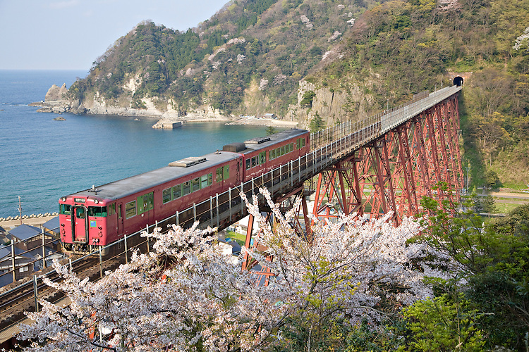 Bantan Line travels over bridge near Amarube, Japan