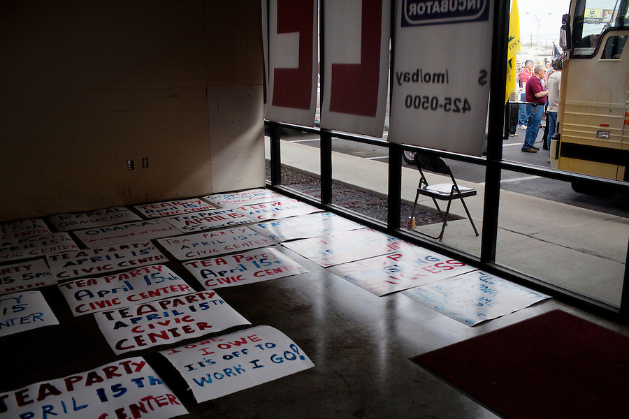 "Evansville, Indiana, April 5, 2010 - Hundreds of hand-painted signs made by local Tea Party activists line the floor of an empty building where the Tea Party Express was holding a rally in the parking lot rally, the eighteenth stop in a 43-city tour across the country, which will conclude with a large rally in Washington, D.C. on April 15, Tax Day. Local organizers say the signs will be used for a local rally on April 15 which will coincide with the Washington D.C. rally. The Tea Party Express tour titled ""Just Vote Them Out"" is taking an aggressive approach by targeting Democratic incumbents competitive districts, as well as Republicans deemed not conservative enough who are facing primary challenges from more conservative candidates. While not endorsing any candidates so far, the Tea Party Express does not hide its desire to replace incumbents with new conservatives that more closely hew to its goals of smaller government and less taxes.."