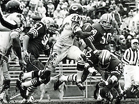 Chicago Bears Dick Gordon against the San Francisco 49ers, Frank Nunley, Ed Beard, and Jimmy Johnson.<br />