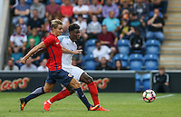 Kortney Hause (Wolverhampton Wanderers) of England passes the ball under pressure from Martin Odegaard (Real Madrid) of Norway during the International EURO U21 QUALIFYING - GROUP 9 match between England U21 and Norway U21 at the Weston Homes Community Stadium, Colchester, England on 6 September 2016. Photo by Andy Rowland / PRiME Media Images.