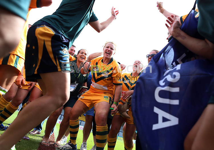 PICTURE BY VAUGHN RIDLEY/SWPIX.COM - Rugby League - Festival of World Cups, Women's Final - Australia Women v New Zealand Women - Headingley, Leeds, England - 14/07/13 - Australia celebrate victory.