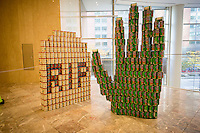 R.I.P. Hunger by Robert Stillman Assoc. in the 22nd annual Canstruction Design Competition in New York, seen on Monday, November 10, 2014, on display in Brookfield Place in Lower Manhattan. This sculpture is comprised of 1312 cans and will feed 1069 New Yorkers. Architecture and design firm participate to design and build giant structures made from cans of food.  The cans are donated to City Harvest at the close of the exhibit. Over 100,000 cans of food were collected and will be used to feed the needy at 500 soup kitchens and food pantries. (© Richard B. Levine)