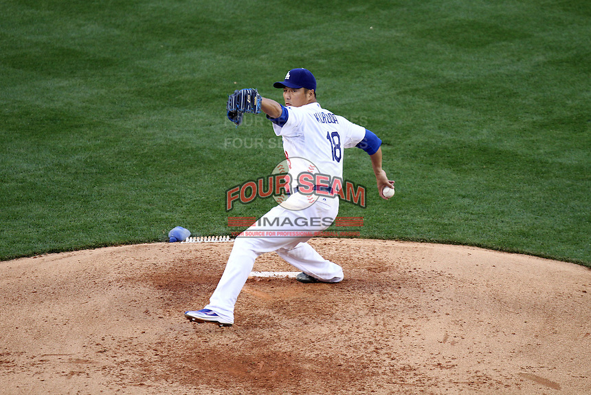 Hideki Kuroda #18 of the Los Angeles Dodgers pitches against the San Francisco Giants at Dodger Stadium in Los Angeles,California on April 3, 2011. Photo by Larry Goren/Four Seam Images