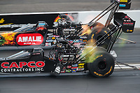 Feb 9, 2019; Pomona, CA, USA; NHRA top fuel driver Billy Torrence (near) races alongside Terry McMillen during qualifying for the Winternationals at Auto Club Raceway at Pomona. Mandatory Credit: Mark J. Rebilas-USA TODAY Sports