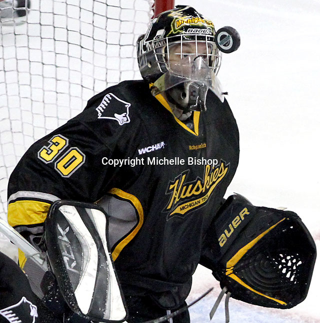 Michigan Tech goalie Josh Robinson gets an up close view of the puck during the second period. UNO defeated Michigan Tech 5-2 Thursday night at Qwest Center Omaha. (Photo by Michelle Bishop)