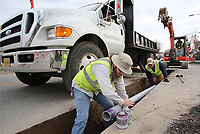 NWA Democrat-Gazette/DAVID GOTTSCHALK Gene Burton, assistant construction supervisor concrete (cq), and Mike Gibbs, construction foreman, both with the city of Springdale Public Works, place Thursday, January 10, 2019, a six inch conduit for an irrigation system on Emma Avenue in Springdale.