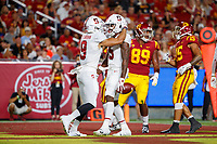 LOS ANGELES, CA - SEPTEMBER 7: Stanford Cardinal wide receiver Connor Wedington #5 celebrates with Osiris St. Brown #9 after scoring a touchdown during a game between USC and Stanford Football at Los Angeles Memorial Coliseum on September 7, 2019 in Los Angeles, California.