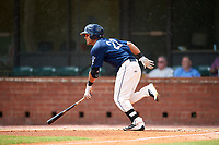 Mobile BayBears center fielder Michael Hermosillo (21) runs to first base during a game against the Pensacola Blue Wahoos on April 26, 2017 at Hank Aaron Stadium in Mobile, Alabama.  Pensacola defeated Mobile 5-3.  (Mike Janes/Four Seam Images)