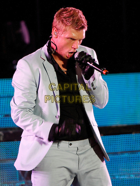 Nick Carter<br /> The Backstreet Boys performed in concert at the Chastain Park Amphitheatre, Atlanta, GA., USA.<br /> August 22nd, 2013<br /> on stage in concert live gig performance performing music half length black shirt white suit singing gloves <br /> CAP/ADM/DH<br /> &copy;Dan Harr/AdMedia/Capital Pictures