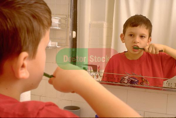 boy brushes teeth in bathroom