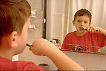 boy brushes teeth in bathroom
