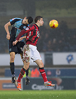 Luke O'Nien of Wycombe Wanderers & Andrew Fleming of Morecambe go up for the ball during the Sky Bet League 2 match between Wycombe Wanderers and Morecambe at Adams Park, High Wycombe, England on 2 January 2016. Photo by Andy Rowland / PRiME Media Images
