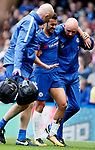 Pedro of Chelsea is helped from the pitch during the premier league match at Stamford Bridge Stadium, London. Picture date 17th September 2017. Picture credit should read: David Klein/Sportimage