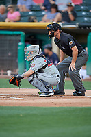 Raffy Lopez (22) of the El Paso Chihuahuas on defense against the Salt Lake Bees as umpire Ben May handles the calls behind the plate at Smith's Ballpark on July 5, 2018 in Salt Lake City, Utah. El Paso defeated Salt Lake 3-2. (Stephen Smith/Four Seam Images)