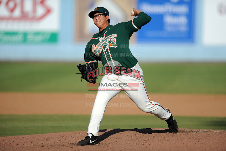 Greensboro Grasshoppers pitcher Beau Wright #28 delivers a pitch during game one of a double header against the Asheville Tourists on July 2, 2013 in Asheville, North Carolina.  The Tourists won the game 5-3. (Tony Farlow/Four Seam Images)