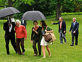 Former United States President George H.W. Bush (2nd,R) walks with  US President George W. Bush as an aide assists former first lady Barbara Bush and first lady Laura Bush (C) walks with daughter Barbara,  as they arrive at the White House from a weekend at the Crawford, Texas ranch, 11 May 2008 in Washington, DC.  Bush, whose daughter Jenna married Henry Hager at the ranch, described the experience as 'spectacular' and 'it's all we could have hoped for'.   <br /> Credit: Mike Theiler / Pool via CNP
