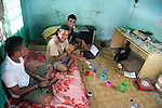 Acacio lives in a cramped, run-down house with several of his friends. Here he jokes with Paulo J Santos (R), who is at university in Dili but not confident about finding a job after he graduates, and unemployed Fernao de Santos, who already knows how hard it is to get work.