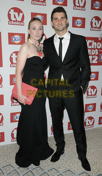 Rosie Marcel & Scott Bunce.The TV Choice Awards at the Dorchester Hotel, Park Lane, London, England..September 10th 2012.full length black strapless dress necklace pink clutch bag necklace beads married husband wife suit white shirt tie.CAP/CAN.©Can Nguyen/Capital Pictures.