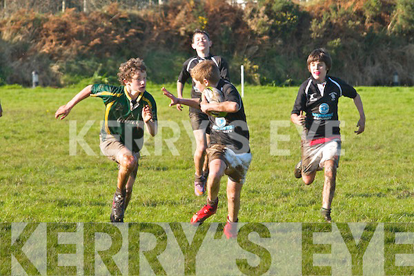 Listowel's Patrick Carmody gets in for a great tackle on Iveragh Eagles Jack Landers in what was a great game in Cahersiveen on Saturday last, Listowel 15 - Iveragh Eagles 12.