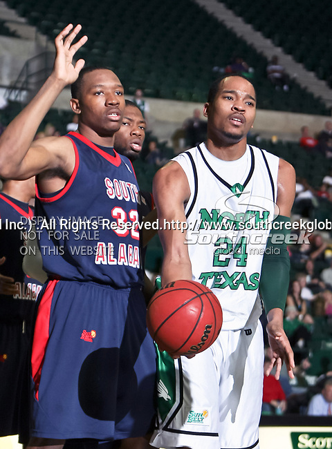South Alabama Jaguars forward Javier Carter (32) and North Texas Mean Green forward Kedrick Hogans (24) in action during the NCAA  basketball game between the South Alabama Jaguars and the University of North Texas Mean Green at the North Texas Coliseum,the Super Pit, in Denton, Texas. UNT defeated South Alabama 82 to 79...