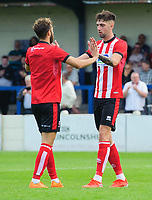 Lincoln City's Jorge Grant celebrates scoring his side's third goal, from the penalty spot, with team-mate Ellis Chapman<br /> <br /> Photographer Chris Vaughan/CameraSport<br /> <br /> Football Pre-Season Friendly (Community Festival of Lincolnshire) - Gainsborough Trinity v Lincoln City - Saturday 6th July 2019 - The Martin & Co Arena - Gainsborough<br /> <br /> World Copyright © 2018 CameraSport. All rights reserved. 43 Linden Ave. Countesthorpe. Leicester. England. LE8 5PG - Tel: +44 (0) 116 277 4147 - admin@camerasport.com - www.camerasport.com