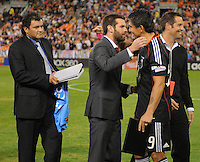 DC United former players Ben Olsen middle Marco Etcheverry left and John Harkes right saluting DC United forward Jaime Moreno in the presentation of his last game.  Toronto FC. defeated DC United 3-2 at RFK Stadium, October 23, 2010.