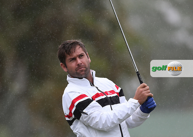 Robert Rock (ENG) stands firm against the elements on par during Round One of The Nelson Mandela Championship 2013 presented by ISPS Handa, at the Mount Edgecombe Country Club, KwaZulu-Natal, South Africa. Picture:  David Lloyd / www.golffile.ie