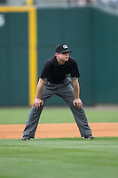 Third base umpire Joseph Born during the International League game between the Norfolk Tides and the Charlotte Knights at BB&T BallPark on June 7, 2015 in Charlotte, North Carolina.  The Tides defeated the Knights 4-1.  (Brian Westerholt/Four Seam Images)