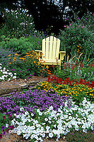 63821-14007 Yellow Adirondack chair in flower garden  Marion Co. IL
