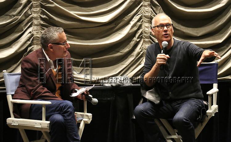 Chris Bonneau and Michael Keaton introduce the Broadway Industry Screening of 'Birdman' at Dolby 88 on October 13, 2014 in New York City.