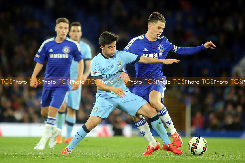 Manuel Garcia Alonso of Manchester City and Chelsea's Charlie Colkett challenge for the ball - Chelsea Youth vs Manchester City Youth - FA Youth Cup Final 2nd Leg Football at Stamford Bridge, London - 27/04/15 - MANDATORY CREDIT: Paul Dennis/TGSPHOTO - Self billing applies where appropriate - contact@tgsphoto.co.uk - NO UNPAID USE