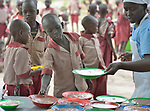 A child is served lunch in the Loreto Primary School in Rumbek, South Sudan. The Loreto Sisters began a secondary school for girls in 2008, with students from throughout the country, but soon after added a primary in response to local community demands.