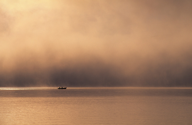 USA, MAINE, MOOSEHEAD LAKE NEAR ROCKWOOD, FISHERMEN IN BOAT, EARLY MORNING, FOG
