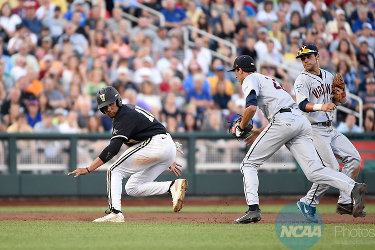 24 JUNE 2014:  John Norwood (10) of Vanderbilt University gets caught in a rundown against the University of Virginia during the Division I Men's Baseball Championship held at TD Ameritrade Park in Omaha, NE.  Virginia defeated Vanderbilt 7-2 in Game Two of the championship series to force a Game Three.  Jamie Schwaberow/NCAA Photos