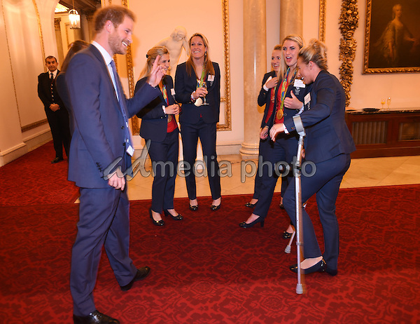 18 October 2016 - London, England - Prince Harry chats to Womens Hockey Team Saskia Clark at a reception for Team GB and ParalympicsGB medallists from the 2016 Rio Olympic and Paralympic Games Buckingham Palace London. Photo Credit: Alpha Press/AdMedia