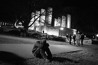 A student mourns near the university's Chapel at night  the day  of the shooting...photo: Hector Emanuel