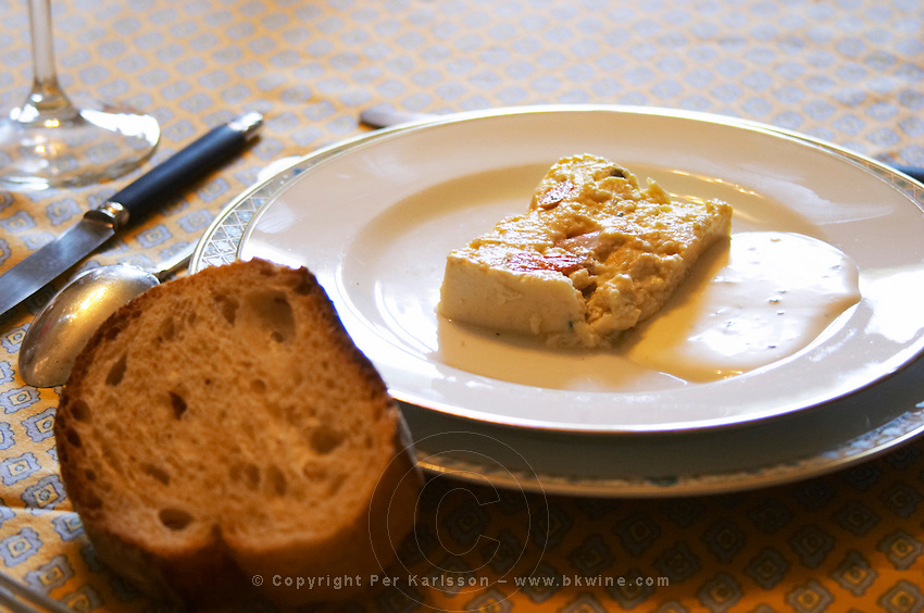 Mas de Perry, Mas Nicot. Terrasses de Larzac. Languedoc. Lunch table set for an opulent meal. Fish and shellfish shell fish mousse pate. France. Europe. In the dining room.