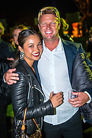 """Caves House Yallingup, Western Australia (Thursday, March 22, 2013) Professional surfer Taj Burrow (AUS) wiht girlfriend Oleema Miller (USA). - .Over 60 metres of red carpet greeted the  1300 guests at the Australian premiere of the surfing movie, Drift, which was shot in Margaret River region and  screened under the stars at Caves House, Yallingup last night...The movie's major celebrity  Sam Worthington was absent from the opening but other big names including Xavier Samuel, fresh from his turn in the Twilight saga, and former McLeod's Daughters actor  Myles Pollard enjoyed the red carpet attention...The premiere will took the film back to its roots in WA's rugged and beautiful South-west region, with a large outdoor screening for over 1,300 people  held in the historic gardens at Caves House in Yallingup. .Drift - A story of passion, corruption, friendship and loyalty, deadly addictions and fractured relationships, tells a tale of courage and the will to survive at all odds...The Australian premiere of Drift was a proud moment for two of the film's West Australian producers, Tim Duffy and Myles Pollard...Myles, who also plays a leading character in the film, was excited to premiere the film to the local community...""""We are ecstatic that the Australian premiere of Drift is happening in the South-west. We have enormous respect for the local community that supported the movie and we're so happy to bring the spotlight back to the region for what promises to be a memorable and historical event,"""" he said...Walking the red carpet were the film's cast, co-directors Morgan O'Neill and Ben Nott, producers Tim Duffy, Myles Pollard and Michele Bennett, local WA crew, local dignitaries and investors, and over 300 extras from the region who feature in Drift...The timing of the premiere coincided with the 2013 Margaret River Pro surfing tournament with many of the world's best surfers attending such as Taj Burrow (AUS), Martin Potter (UK) and former WCT surfer Jake Paters"""