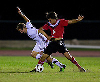 Nathan Smith (4) of the United States fights for the ball with Parker Seymour (6) of Canada during the finals of the CONCACAF Men's Under 17 Championship at Catherine Hall Stadium in Montego Bay, Jamaica. The United States defeated Canada, 3-0, in overtime