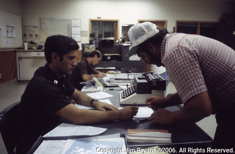 A U.S. Border Patrol agent in Del Rio, Texas, fills out paperwork with a suspected illegal alien.   While the traditional mission of the United States Border Patrol has always been the detection and prevention of the illegal entry of aliens and smuggling of illegal contraband into the United States anywhere other than a designated port-of-entry, the dawn of the age of terrorism within our nation has added a new and high priority mission: to detect and prevent the entry of terrorists and their weapons into the United States. Jim Bryant Photo..©2006. All Rights Reserved.