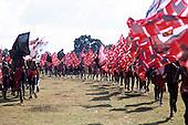Lolgorian, Kenya. Siria Maasai; moran warriors taking part in the eunoto coming of age ceremony carrying flags.