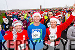 Alan Kelliher, John Flynn and Shane Flynn, pictured at the Santa 5k run which took place at Tralee Wetlands Centre on Sunday.