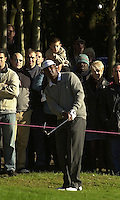 Photo Peter Spurrier.19/10/2002 Sat.CISCO World Matchplay Championships - Wentworth.The 'Gallery' watch Vijay Singh chip onto the 1st green...[Mandatory Credit Peter Spurrier/ Intersport Images]