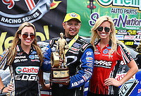 Apr 27, 2014; Baytown, TX, USA; NHRA funny car driver Robert Hight (center) celebrates with teammates Brittany Force (left) and Courtney Force after winning the Spring Nationals at Royal Purple Raceway. Mandatory Credit: Mark J. Rebilas-