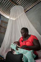 HAYAT SEBIT sits with her four-month-old Lado, in her home near the Munuki Healthcare Center in Juba, South Sudan. Patients receive among other things a moquito net for their home to help fight malaria. The center deals with maternity, malaria, tuberculosis, HIV/AIDS and other common conditions. With funding from USAID, Jhpiego, an affiliate of Johns Hopkins University, operates the center.