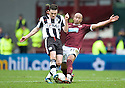 ST MIRREN'S STEVEN THOMSON IS CHALLENGED BY HEARTS' MEHDI TAOUIL