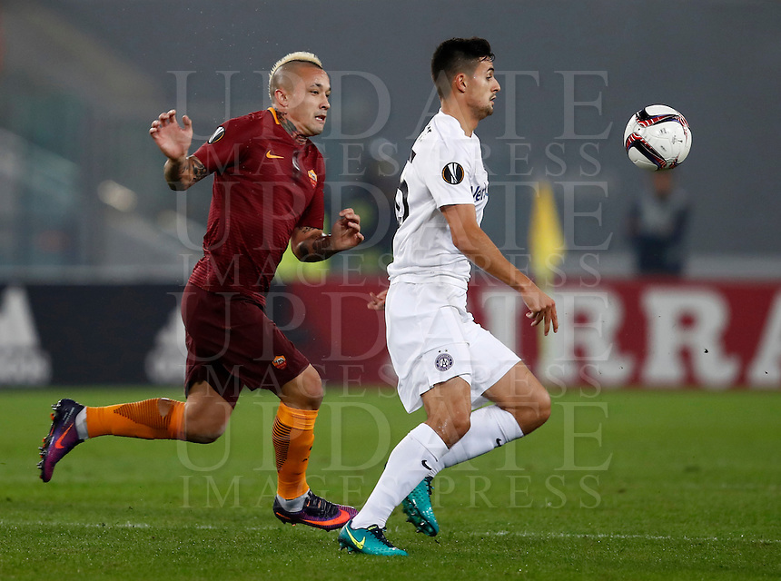 Calcio, Europa League, Gguppo E: Roma vs Austria Vienna. Roma, stadio Olimpico, 20 ottobre 2016.<br /> Austria Wien's Tarkan Serbest, right, is chased by Roma's Radja Nainggolan during the Europa League Group E soccer match between Roma and Austria Wien, at Rome's Olympic stadium, 20 October 2016. The game ended 3-3.<br /> UPDATE IMAGES PRESS/Isabella Bonotto