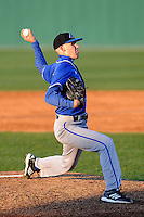 Pitcher Lucas Clarke (27) of the UNC Asheville Bulldogs delivers in a game against the University of South Carolina Upstate Spartans on Tuesday, March, 25, 2014, at Cleveland S. Harley Park in Spartanburg, South Carolina. (Tom Priddy/Four Seam Images)
